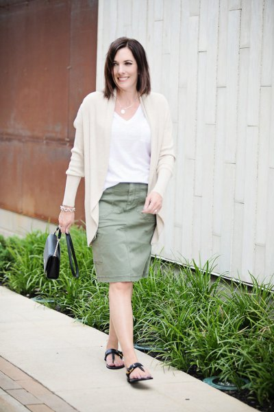 Light pink cardigan with a white V-neck t-shirt and a knee-length skirt