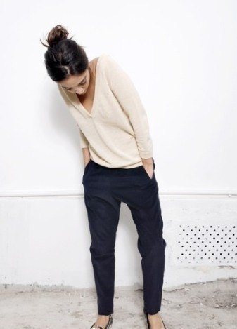 Light pink V-neck sweater and black chinos