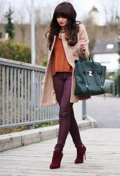 Light pink wool coat with purple skinny jeans