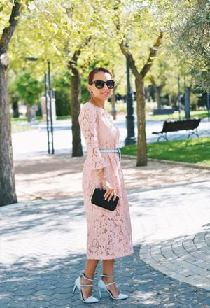 Light yellow maxi dress with bell sleeves and belt with pink strappy heels