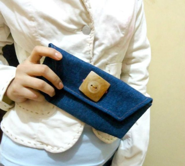 light yellow buttoned linen blouse with a cute mini purse made of blue denim