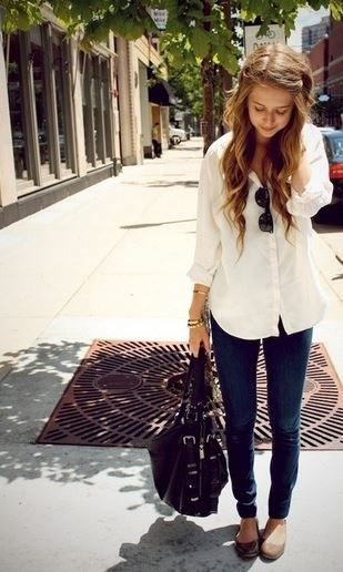 pale yellow long blouse with buttons and slim cut black jeans