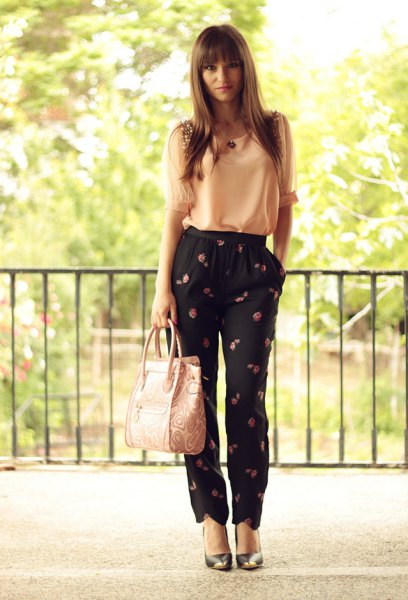 Light yellow chiffon tank top with black pants with a floral pattern