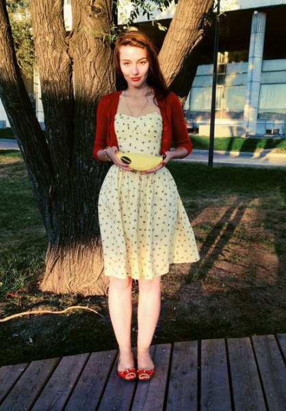 Light yellow fit and flared mini dress with short burgundy cardigan