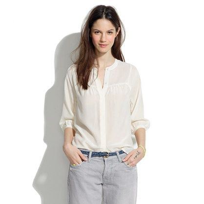 Light yellow shirt without a collar with light gray jeans