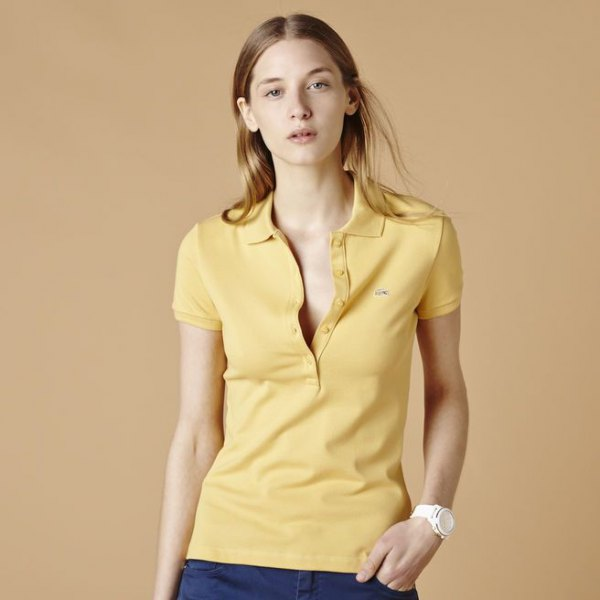 Light yellow polo shirt with dark blue skinny jeans