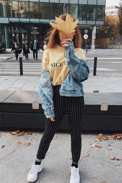 Light yellow printed sweatshirt with black and white striped trousers