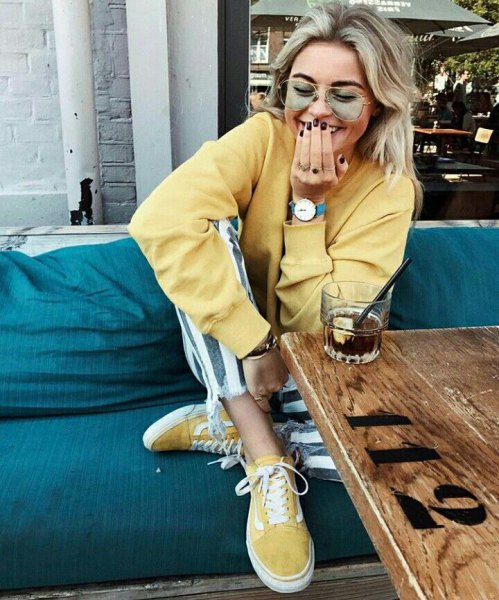 Light yellow sweatshirt with matching canvas sneakers