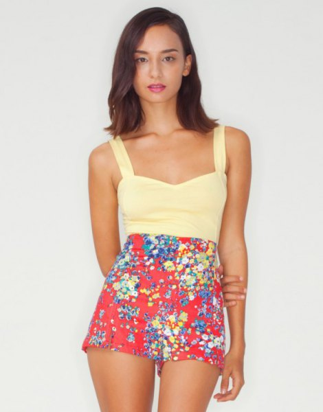 Light yellow tank top with red mini shorts with a floral pattern