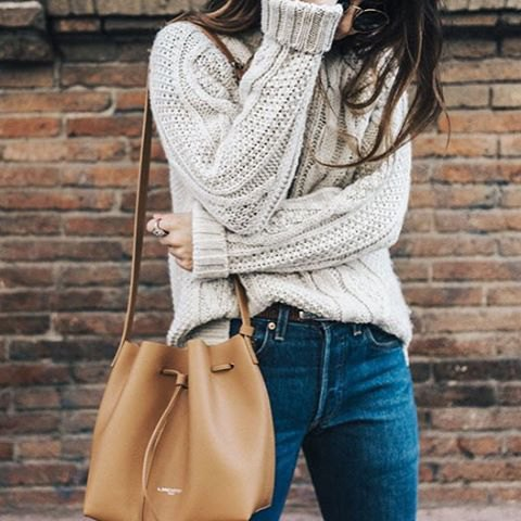 partly hidden in the chunky sweater outfit