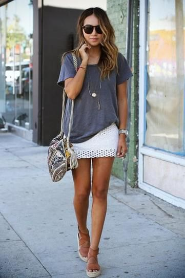 partially hidden oversized t-shirt white skirt