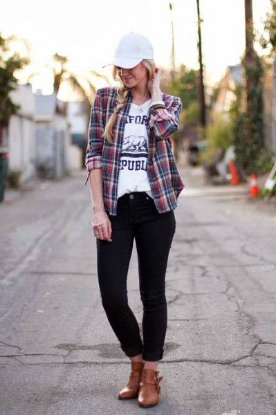 pink and dark blue plaid shirt with white baseball cap