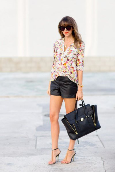 pink and white chiffon blouse with floral pattern and black leather shorts