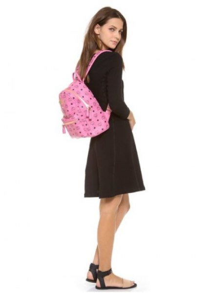pink backpack wallet with black sweater and gray minirater skirt