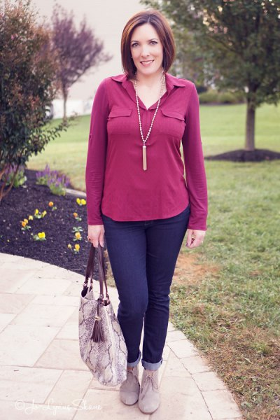 pink blouse with dark blue jeans with cuffs and gray suede boots