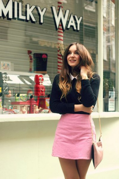 pink figure-hugging mini skirt black knitted sweater