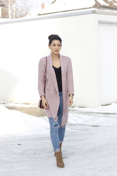 pink cardigan with black v-neck and ripped jeans