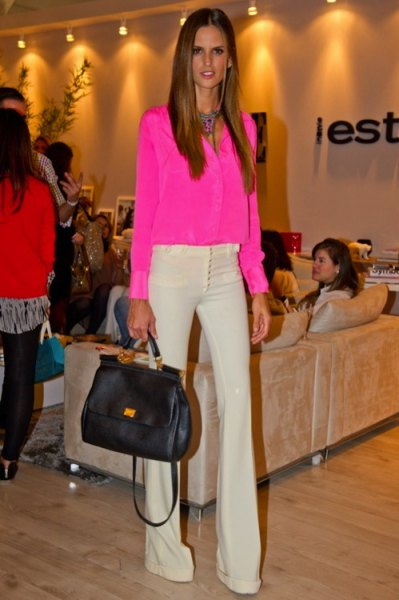 pink chiffon blouse with buttons and light yellow flared trousers