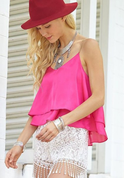 sleeveless top made of pink chiffon with mini-shorts made of white lace
