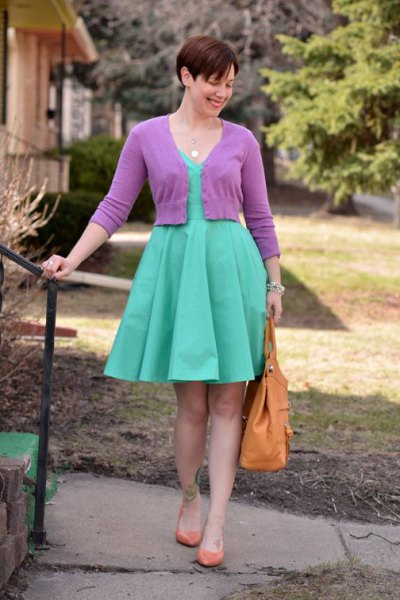 pink short-cut cardigan with a knee-length pleated dress