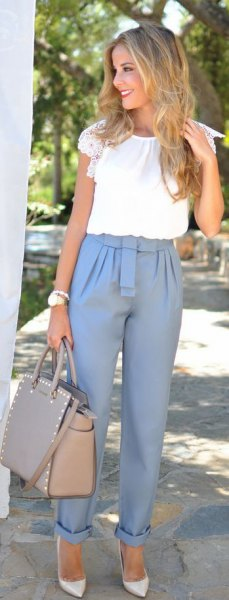 pink suit trousers with cuffs and white short-sleeved blouse