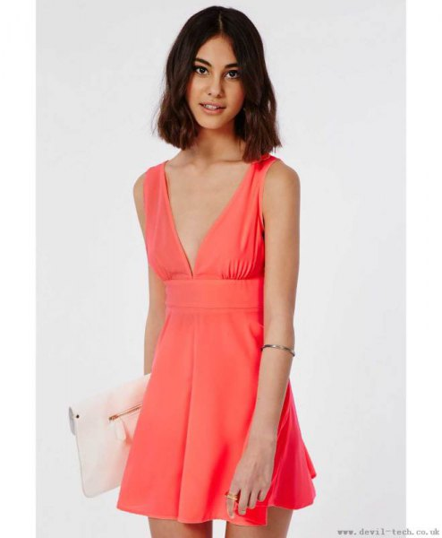 pink mini hangover dress with deep V-neckline and white clutch