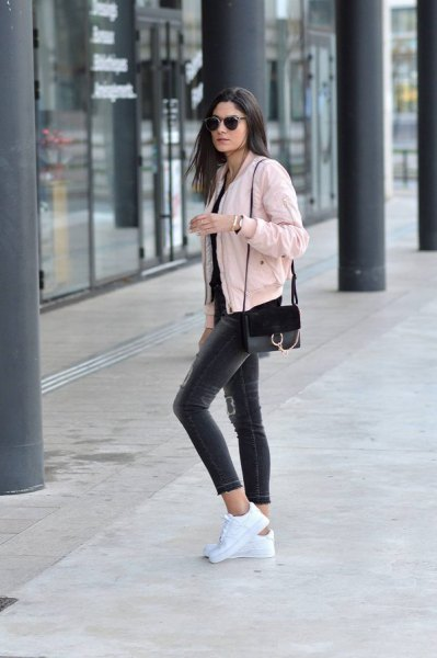 pink denim jacket with a completely black outfit
