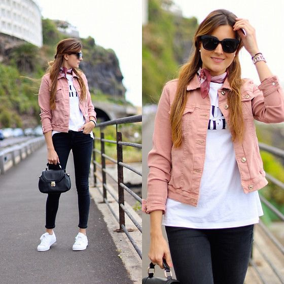 pink denim jacket with white printed t-shirt and black skinny jeans