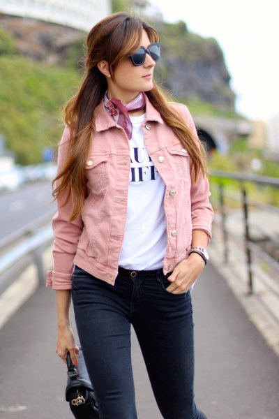 pink denim jacket with white printed t-shirt and light blue silk choker scarf