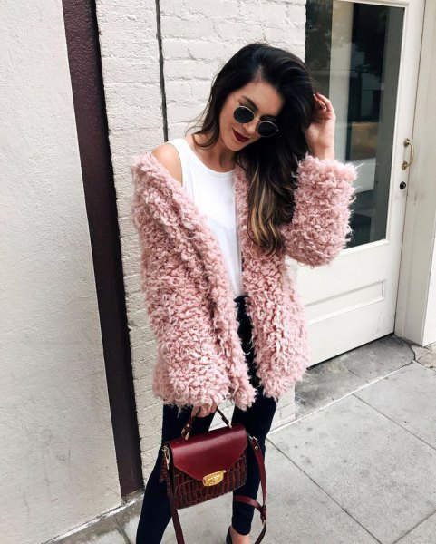 pink fuzzy sweater cardigan with white vest top and black jeans