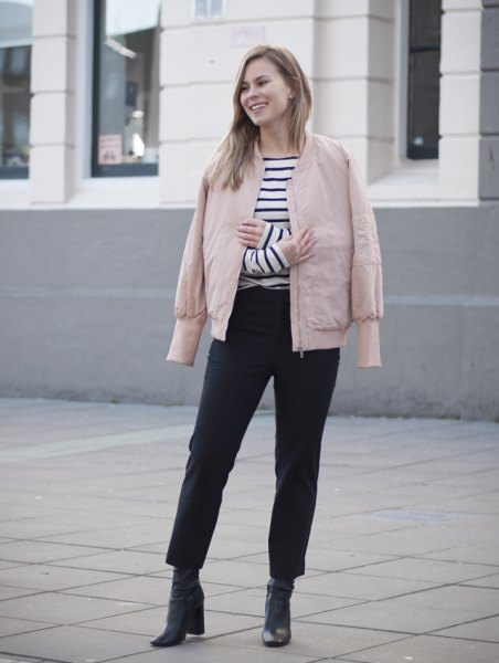 pink jacket black and white striped t-shirt