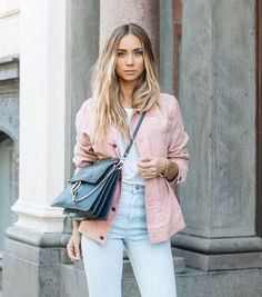 pink jacket with white t-shirt and light blue mom jeans