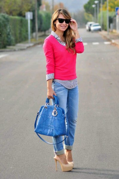 pink knitted sweater with black and white polka dot shirt and cuffed jeans