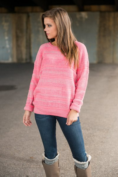 pink knitted sweater with knee-high boots made of gray suede