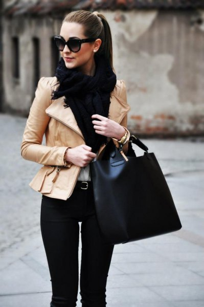 pink leather jacket with a slim fit, black scarf and white blouse