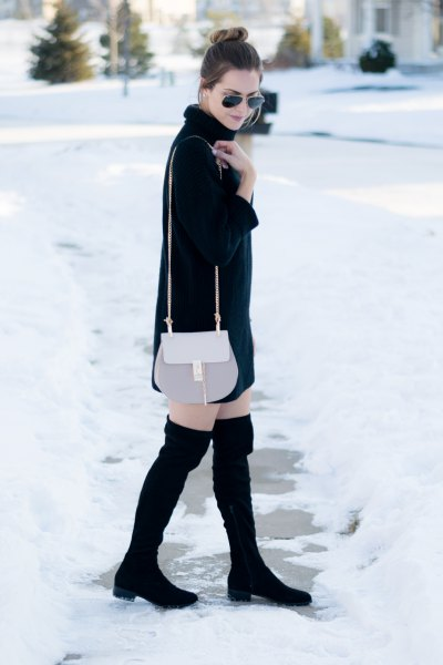 pink smart wallet and black thigh high boots