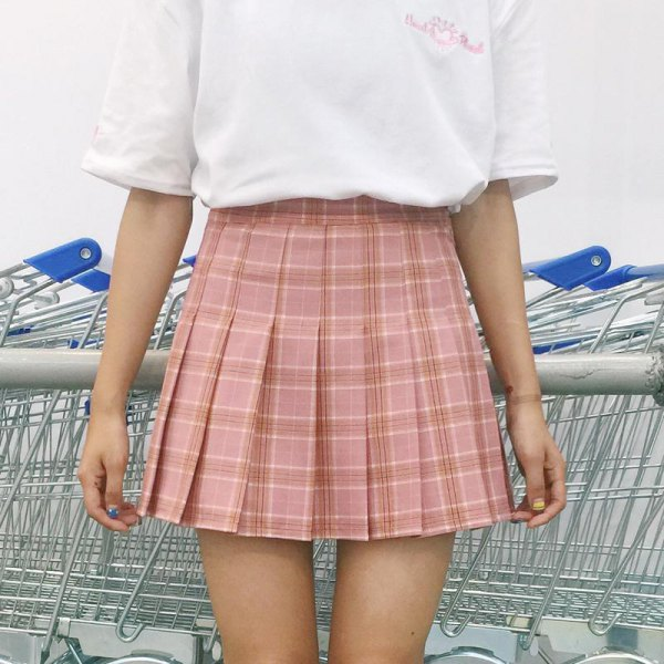 pink pleated checkered skirt with white t-shirt with wide sleeves