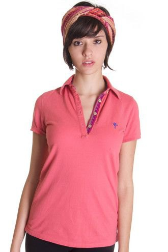 pink polo shirt with red headband and dark jeans