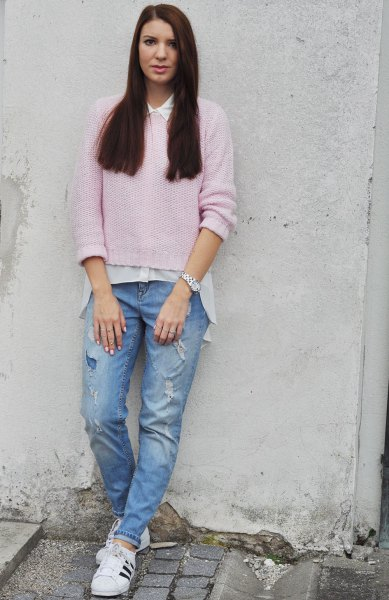 pink sweater with white oversized shirt and blue boyfriend jeans