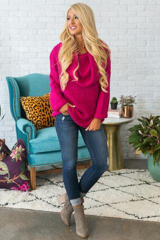 pink ribbed, chunky sweater with cuffed jeans and gray boots