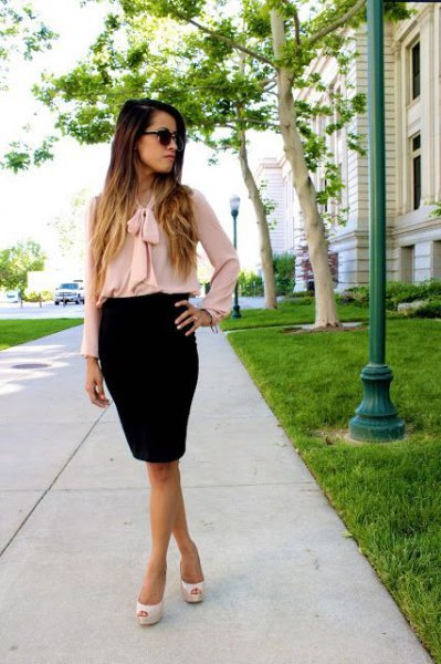 Chiffon blouse with pink bow and black pencil skirt