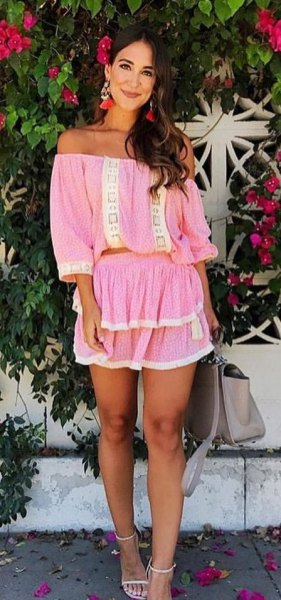 pink ruffle mini skirt from shoulder up