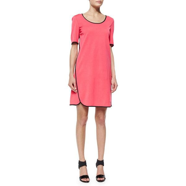 pink short-sleeved mini dress with black sandals