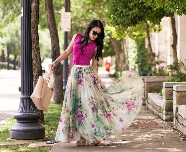 pink sleeveless, figure-hugging top with flowing chiffon skirt with a floral pattern