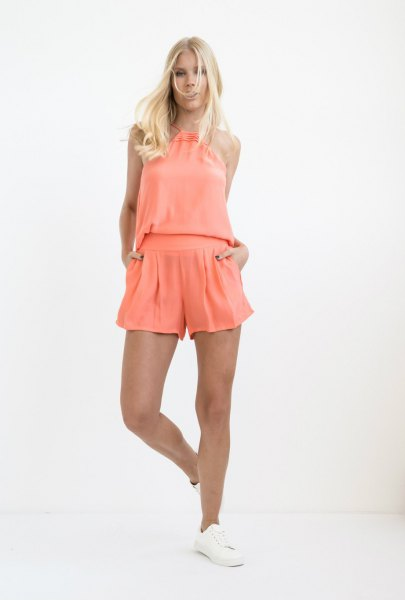pink sleeveless top with matching pleated mini silk shorts