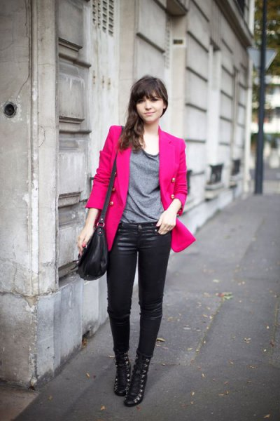 pink, slightly oversized blazer with gray t-shirt and leather pants
