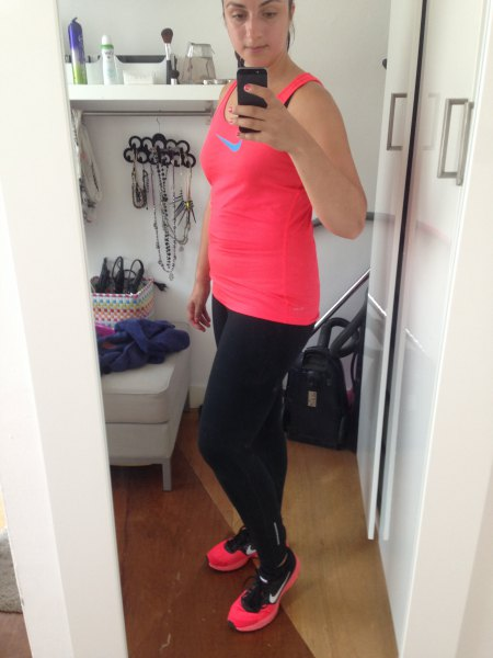 pink tank top with black running leggings and sneakers