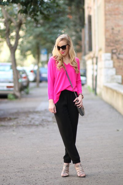 pink V-neck sweater and black chinos