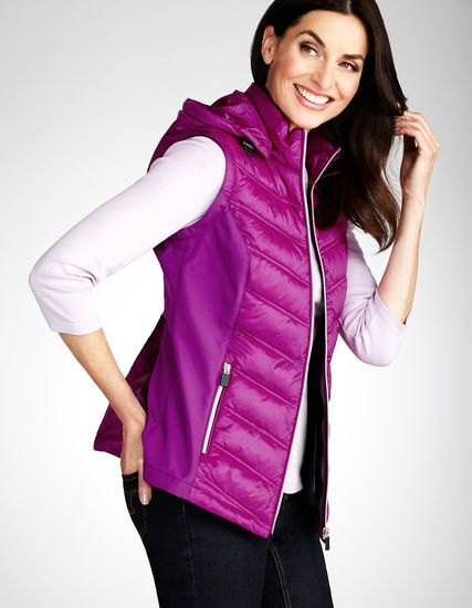 pink hooded vest with white top and black jeans