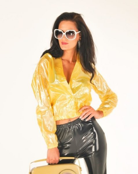 yellow plastic bomber jacket with matching black pants
